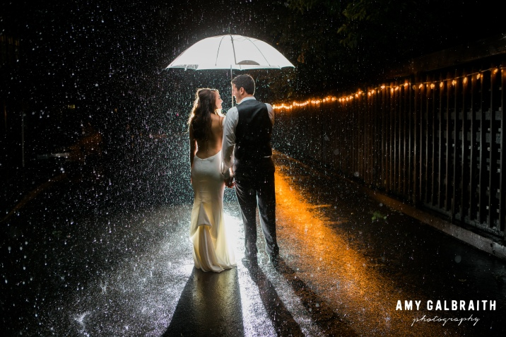 Rain on your wedding day is good luck! Especially if you get a photo like this!